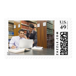 Business people doing research in library postage stamp