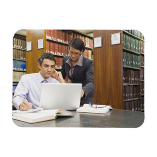 Business people doing research in library rectangular photo magnet