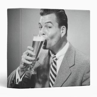 Businessman Drinking Beer Binder