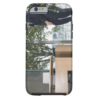 Businessman playing golf in an office tough iPhone 6 case