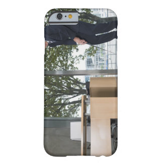 Businessman playing golf in an office barely there iPhone 6 case