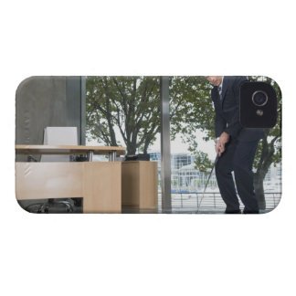 Businessman playing golf in an office iPhone 4 Case-Mate case