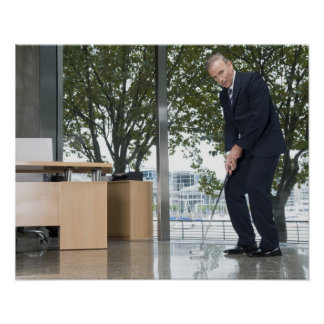 Businessman playing golf in an office poster