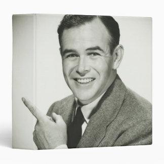 Businessman Pointing Binder