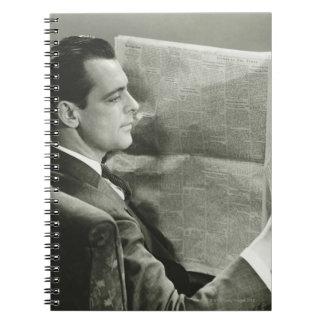 Businessman Reading the Newspaper Spiral Notebook