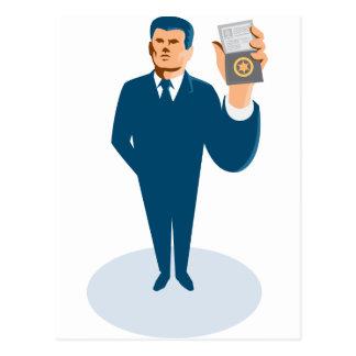 businessman secret agent showing id card badge wal post card