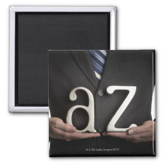 Businessman with A to Z letters Magnet
