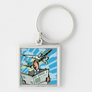 Businessman with newspaper and airplane above keychain