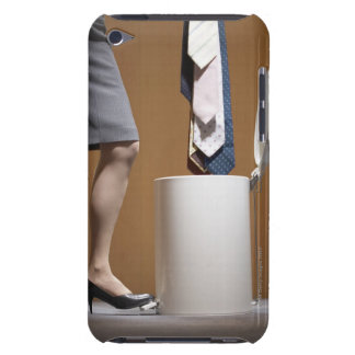 Businesswoman throwing ties to trashcan, low barely there iPod covers