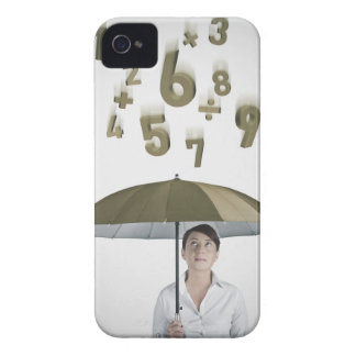 Businesswoman under umbrella with numbers and iPhone 4 case