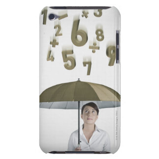 Businesswoman under umbrella with numbers and iPod touch case