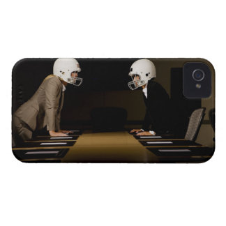 Businesswomen in face-off wearing football Case-Mate iPhone 4 cases