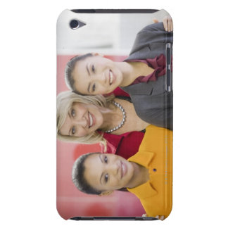 Businesswomen smiling in office iPod touch case