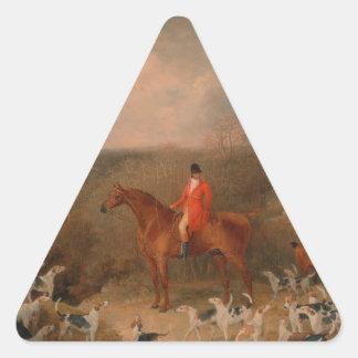 Búsqueda con los perros y la pintura al óleo pegatina triangular