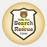 Búsqueda y equipo de rescate del oso de peluche etiquetas redondas