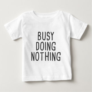 Busy doing nothing baby T-Shirt