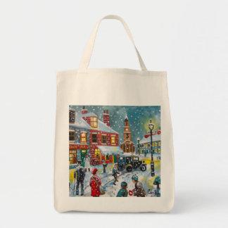 Busy street scene winter snow  Gordon Bruce art Tote Bags
