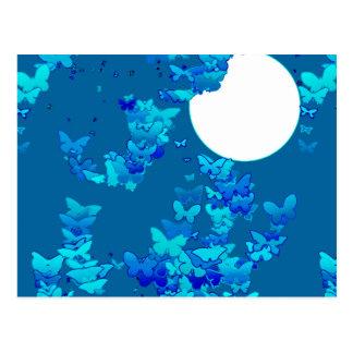 Butterflies against blue night sky, moonscape postcard