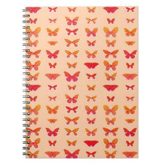 Butterflies, gold, coral, soft orange background notebook