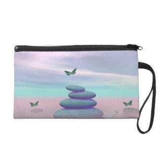 Butterflies in flight in a Zen landscape Wristlet