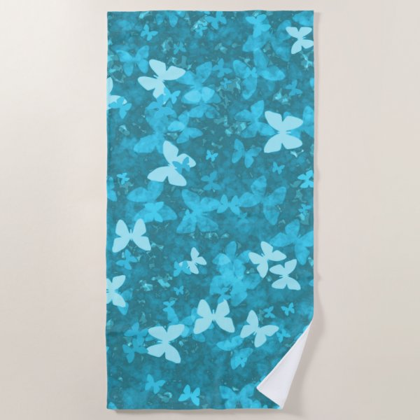 butterflies in the blue beach towel