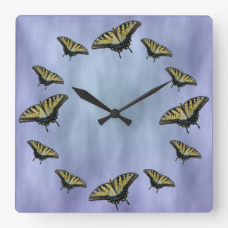 Butterflies in the clouds. square wall clock