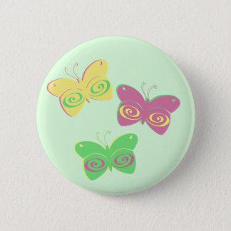 Butterflies on light green background pinback button