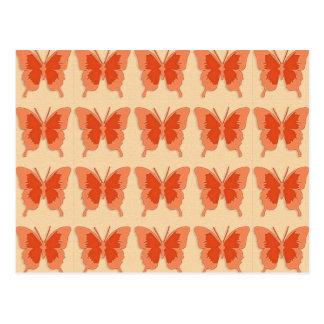 Butterflies, orange on a pastel orange background postcard
