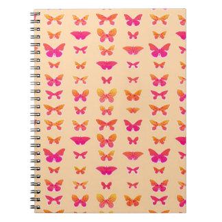 Butterflies, soft orange, coral pink, gold spiral notebook