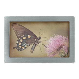 Butterfly drinking necter from flower belt buckles