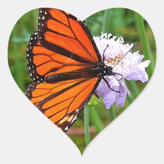 Butterfly feeding on a flower heart sticker