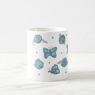 butterfly flutter by blue coffee mug