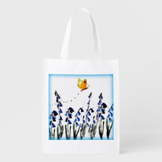 Butterfly flying above Bluebells Floral Art Grocery Bags