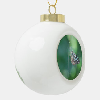 Butterfly Hanging From A Twig Ceramic Ball Christmas Ornament