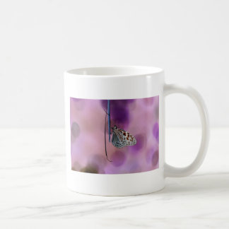 Butterfly Hanging From A Twig Coffee Mug