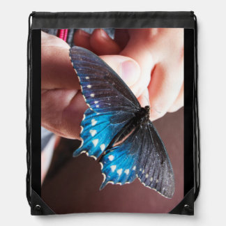 Butterfly on a Child's Hands Drawstring Backpack