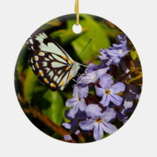 Butterfly on flower ceramic decoration