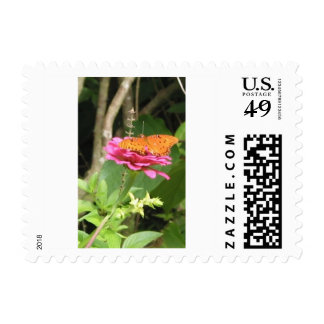 Butterfly on flowers stamp