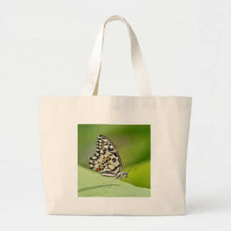 Butterfly on leaf large tote bag