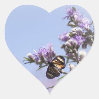 Butterfly on purple blossom branch heart sticker