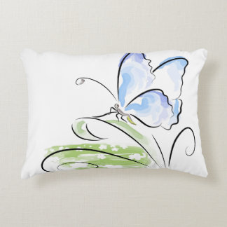 Butterfly sitting on grass over flower field accent pillow
