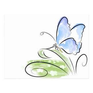 Butterfly sitting on grass over flower field postcard