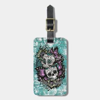 Butterfly sugar skulls illustration in blue. bag tag