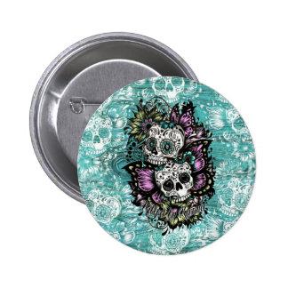 Butterfly sugar skulls illustration in blue. button