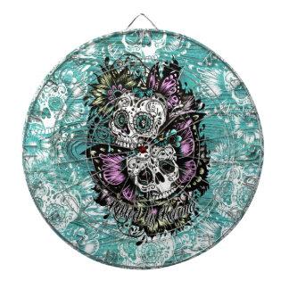 Butterfly sugar skulls illustration in blue. dartboards