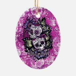 Butterfly sugar skulls on pink wood base. Double-Sided oval ceramic christmas ornament