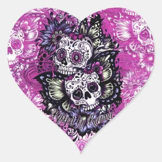 Butterfly sugar skulls on pink wood base. heart sticker