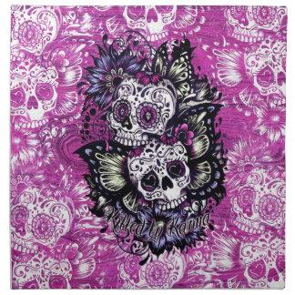 Butterfly sugar skulls on pink wood base. napkin