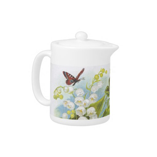 Butterfly teapot with lily of the valley and roses