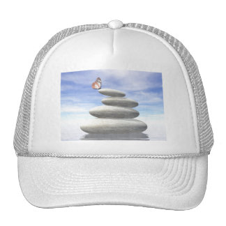 Butterfly upon balanced stones trucker hat